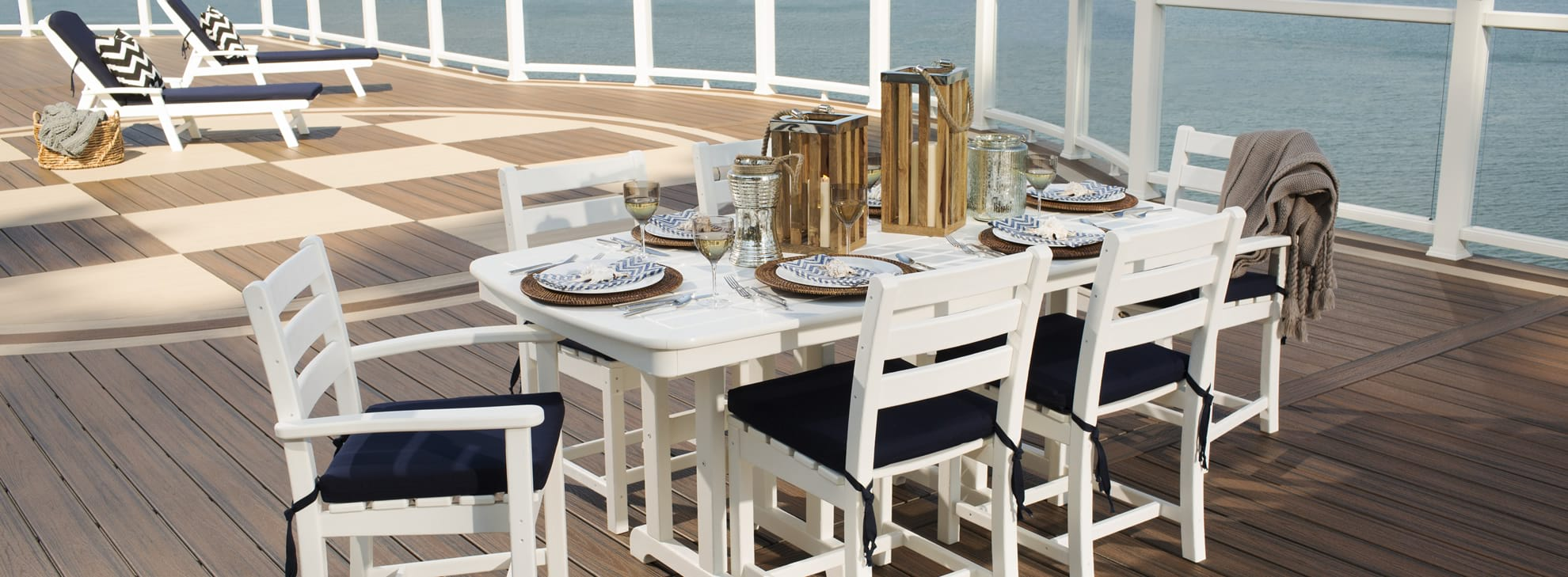 White dining set with blue cushions